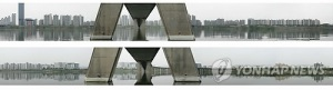 From Yonhap, copy of part of the series of photographs of Seoul as seen on the North and South sides of the Han river.