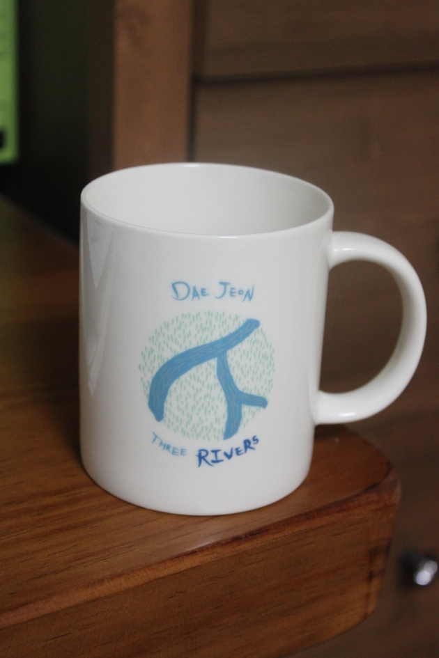 The English language side of the Daejeon mug cup. The three rivers that define the city are the Gapcheon River, the Yudeungcheon River and the Daejeon Cheon River.