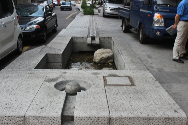 What was once sewer water is now an small creek running in downtown Seoul.