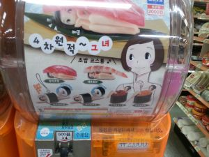 Disturbing sushi girl toy from dispenser in the subway station